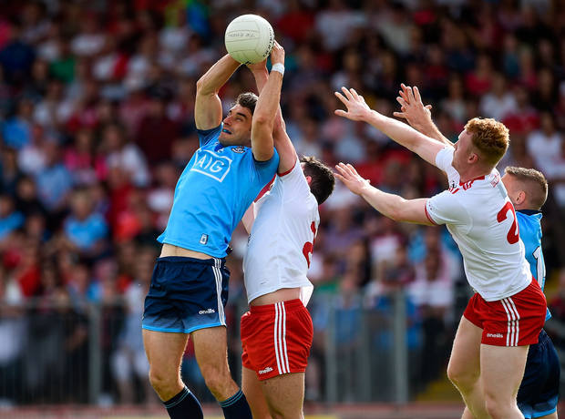 Bernard Brogan in an aerial duel with Tyrone's Ciaran McLaughlin. Photo by Oliver McVeigh/Sportsfile