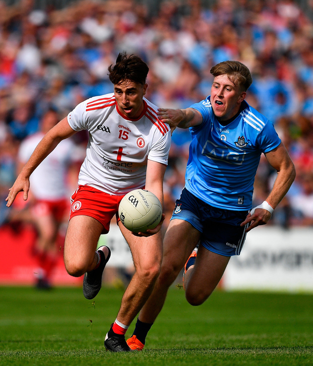 Conall McCann of Tyrone in action against Seán Bugler of Dublin. Photo by Brendan Moran/Sportsfile