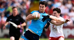 Michael Darragh MacAuley of Dublin in action against Rory Brennan of Tyrone. Photo by Oliver McVeigh/Sportsfile