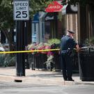 Police continue their investigation after a mass shooting in a popular nightlife district in Dayton, Ohio (Photo by Scott Olson/Getty Images)