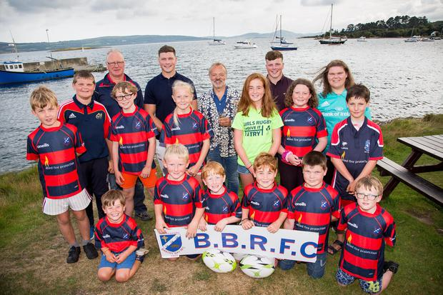 Festival fun: TV favourite Graham Norton and rugby stars Fineen and Josh Wycherley meet Bantry Bay Rugby Club youngsters at the Ahakista August Festival. PHOTO: ALISON MILES