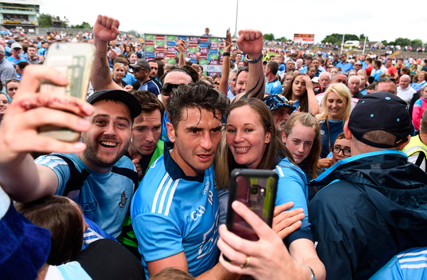 Dublin fans secure 'selfies' with Bernard Brogan after the clash against Tyrone which felt more like a challenge match. Photo by Oliver McVeigh/Sportsfile