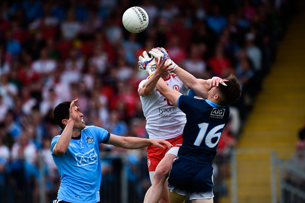 MY BALL: Dublin keeper Evan Comerford beats Tyrone's Richie Donnelly in this aerial duel. Photo by Oliver McVeigh/Sportsfile