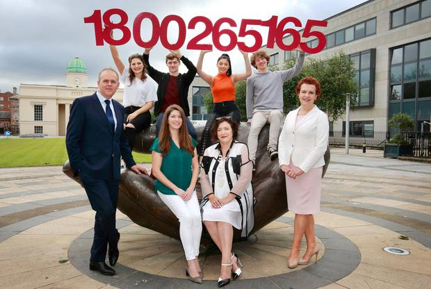 Just a call away: (front, left-right) Education Minister Joe McHugh with Roisin O'Donohoe from the Institute of Guidance Counsellors, Mai Fanning, president of the National Parents Council post-primary, and Katherine Donnelly, Education Editor for the Irish Independent, along with students Emma Nicholson (18), Luke O'Shea (18), Etaine Fanning (17) and Jack O'Shea (18). Photo: Frank McGrath