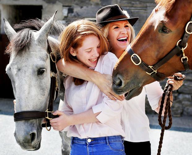My lovely horse: Yvonne Connolly and daughter Ali Keating prepare to compete in the showing classes at the Dublin Horse Show. Photo: Steve Humphreys