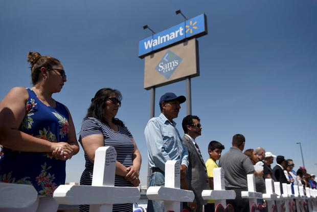People pray next to a row of crosses representing each of the victims at a growing memorial site two days after a mass shooting at a Walmart store in El Paso, Texas. Photo: REUTERS/Callaghan O'Hare/File Photo