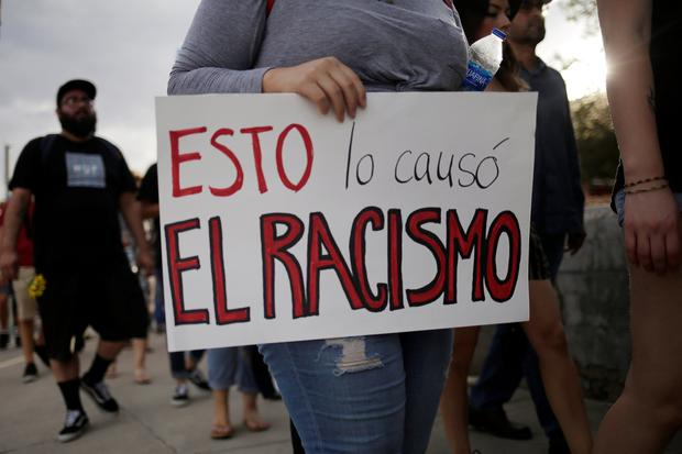 People take part in a rally against hate a day after a mass shooting at a Walmart store, in El Paso, Texas. The placard reads, 'This is caused by racism'. Photo: REUTERS/Jose Luis Gonzalez