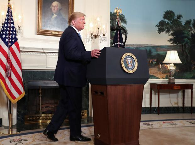 U.S. President Donald Trump arrives to speak about the shootings in El Paso and Dayton in the Diplomatic Room of the White House in Washington. Photo: REUTERS/Leah Millis