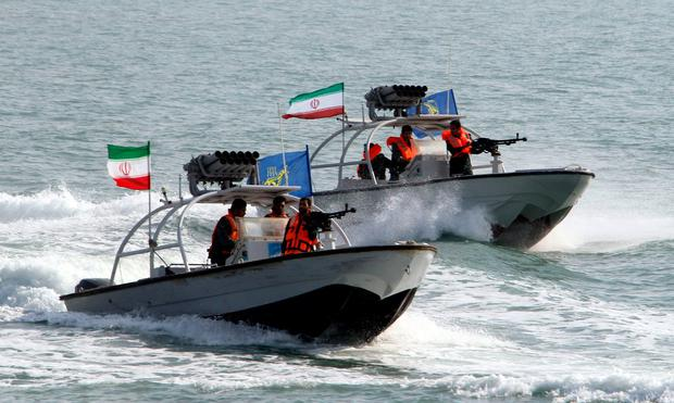 Gun boats: Iranian Revolutionary Guards patrol the Gulf waters. Photo: Atta Kenare/AFP/Getty Images