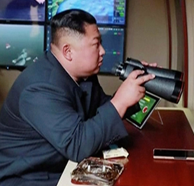 Watching brief: Kim Jong-Un watches the latest round of missiles being fired. Photo: KRT via AP Video