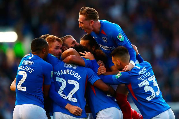 Ellis Harrison of Portsmouth celebrates with team-mates after scoring the opening goal during the Carabao Cup First Round match between Portsmouth and Birmingham City at Fratton Park
