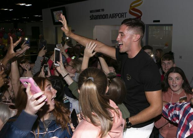 Love Island winner Greg O'Shea back home at Shannon Airport. Picture: Kyran O'Brien