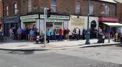 Fans queue for tickets to Dublin vs Mayo outside the GAA ticket office on Dorset Street.