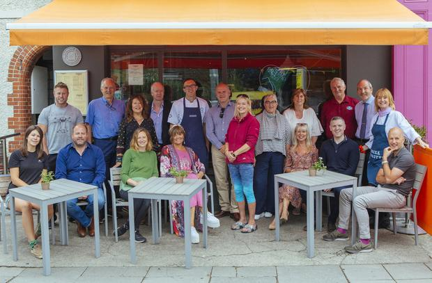 Village people: Local Glasthule business owners who have taken part in the green initiative. Photo: Kyle Tunney