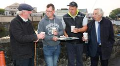 Hospitality aplenty from all over for members of the Beef Plan Movement picketing Meadow Meats, Rathdowney, Co. Laois. From left: Tommy Fitzpatrick, Tom Delaney, William Fitzpatrick and Michael Kelly. Photograph: Alf Harvey.