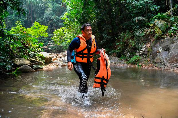 Emergency: A Malaysian diver takes part in the search for Nora Quoirin in Seremban, Malaysia. Photo: MOHD RASFAN/AFP/Getty Images
