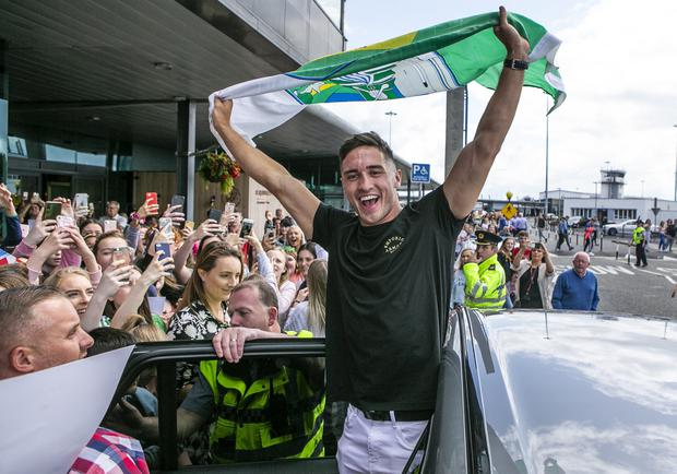 Adulation: 'Love Island' winner Greg O'Shea is mobbed as he leaves Shannon Airport. Photo: Kyran O'Brien