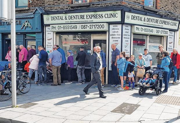 When Saturday comes: Supporters in Dublin form an orderly queue as they go in search of All-Ireland semi-final tickets on Dorset St yesterday