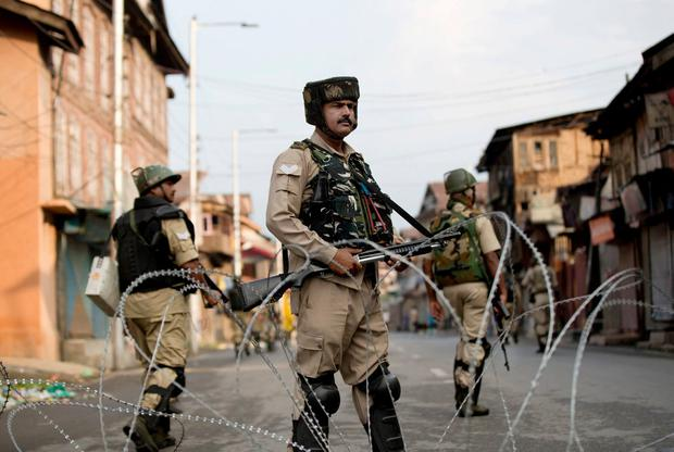 Indian Paramilitary soldiers stand guard during curfew in Srinagar, Indian controlled Kashmir. Photo: Dar Yasin/AP Photo