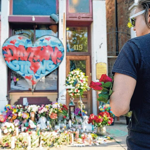 Poignant: An Oregon resident stands at a memorial for those killed during the mass shooting in Dayton, Ohio. Photo: Bryan Woolston/Reuters