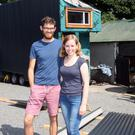 Michael Rauch (25) and his girlfriend Alex Connolly (25) are building their first home on the back of a flatbed trailer.