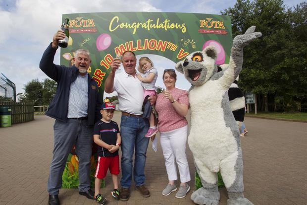 Sean McKeown, Director of Fota Wildlife Park, pictured with Darragh, 6, Mike, Laura, 4, and winner Catherine Cullinane as she became Fota Wildlife Park's 10 millionth visitor. Pic: Diane Cusack