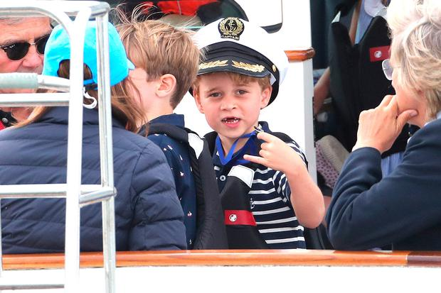 George and cheeky Charlotte watch Kate take regatta wooden spoon