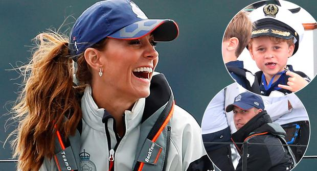 Britain's Catherine, Duchess of Cambridge smiles as she skippers a sailing boat in the eight boat regatta,