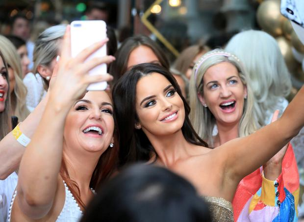 Maura Higgins pictured with fans at the launch of the Bellamianta Luxury Tan at Cafe En Seine. Picture Credit:Frank McGrath