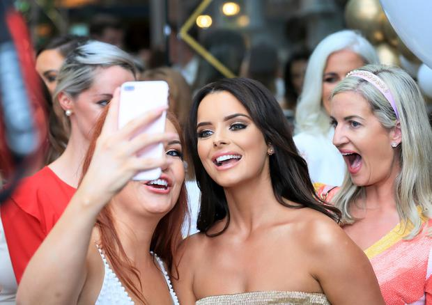 Home at last: Maura Higgins takes pictures with fans at Café En Seine in Dublin. Photo: Frank McGrath