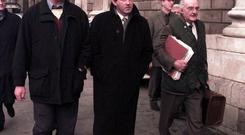 Tom Parlon, Former IFA President (centre) with Raymond O'Malley (LT) and the late Michael Staines, solicitor, arriving at the high court on January 17, 2000.