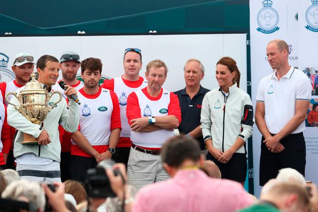 Enda Kenny, Britain's Prince William and Kate Middleton watch on as Bear Grylls is awarded the King's Cup Photo credit: Andrew Matthews/PA Wire