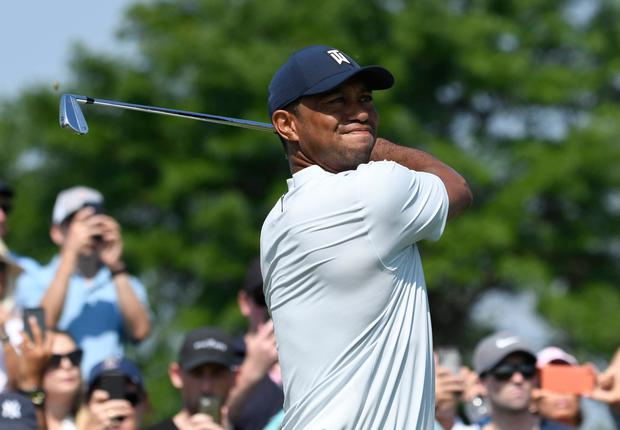 Tiger Woods hits his tee shot on the 4th hole during the first round of The Northern Trust golf tournament at Liberty National Golf Course. Photo: Mark Konezny/USA Today Sports