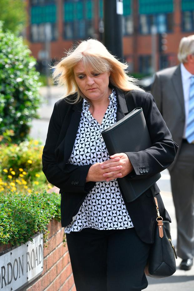 Sherry Bray, 48, leaving Swindon Magistrates' Court, where she will appear again today, with Christopher Ashford, 62, charged over a morgue photograph of footballer Emiliano Sala. Ben Birchall/PA Wire