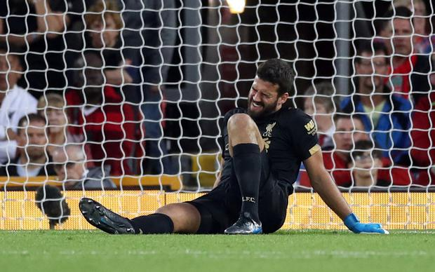 Liverpool's Alisson reacts after sustaining an injury