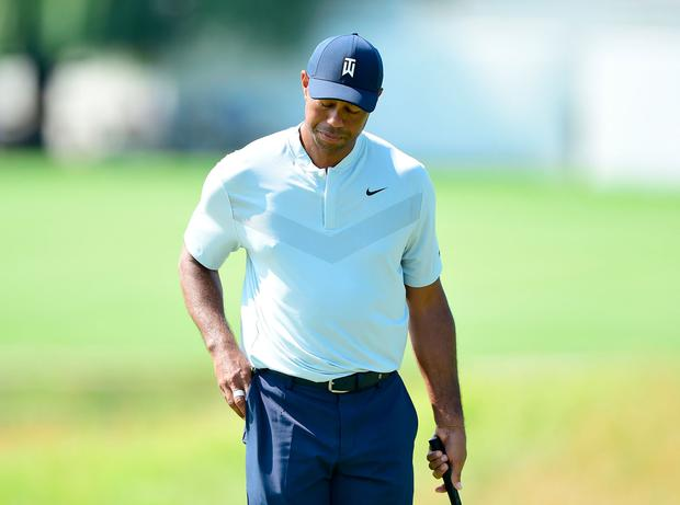 Tiger Woods feeling the strain on the opening day of the Northern Trust. Photo: Getty