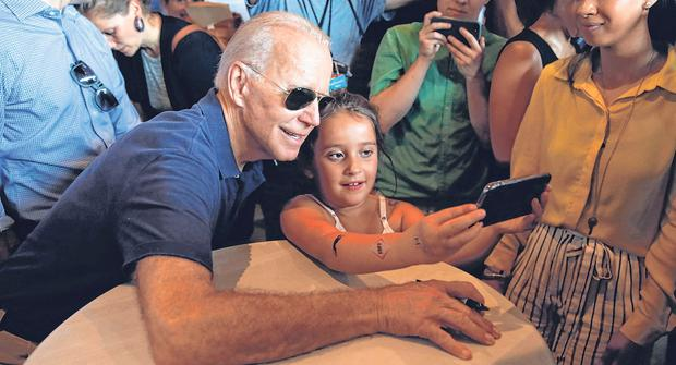 Selfie awareness: Joe Biden and a young fan take a photo together at the Iowa State Fair in Iowa. Photo: AP