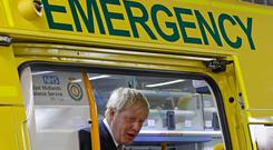 Prime Minister Boris Johnson inspects an ambulance during a visit to Pilgrim Hospital in Boston, Lincolnshire. Darren Staples/PA Wire