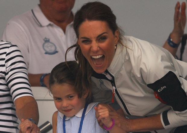 Britain's Catherine, Duchess of Cambridge, reacts after Britain's Princess Charlotte sticked her tongue out before a presentation ceremony following the King's Cup Regatta in Isle of Wight, Britain August 8, 2019. REUTERS/Peter Nicholls