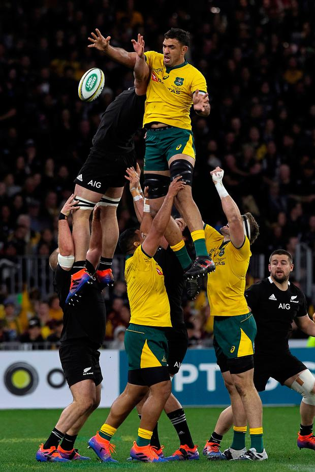 Australia's Rob Simmons takes lineout ball over Scott Barrett of New Zealand during the Rugby Championship Bledisloe Cup Test match between the Australian Wallabies and New Zealand All Blacks in Perth
