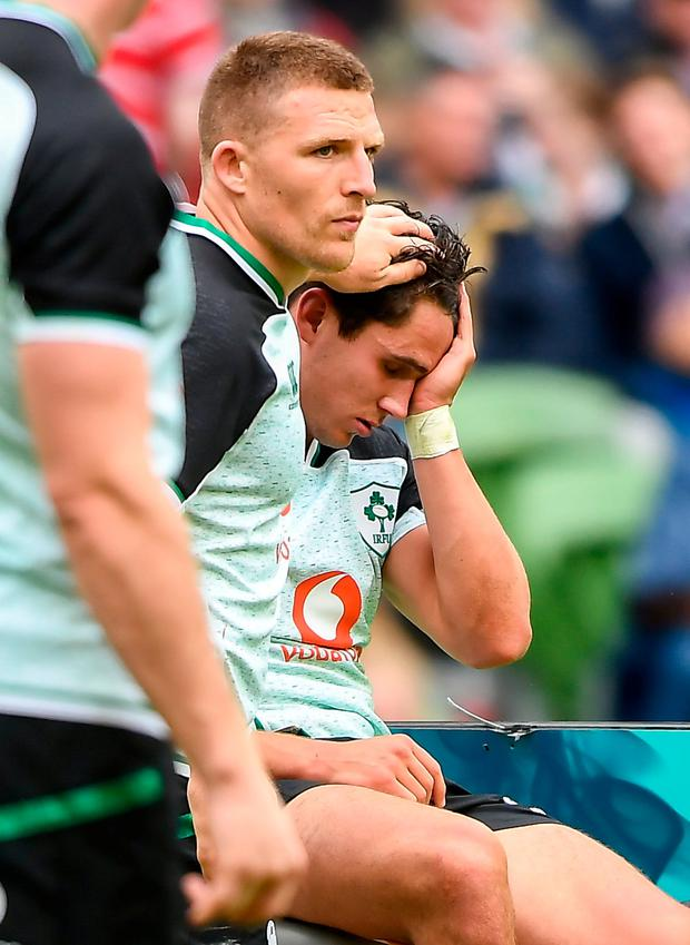 Joey Carbery of Ireland is consoled by Andrew Conway after receiving an injury during the Guinness Summer Series 2019 match between Ireland and Italy at the Aviva Stadium in Dublin. Photo by David Fitzgerald/Sportsfile