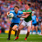 Dublin's Michael Fitzsimons is challenged by Cillian O'Connor of Mayo during the All-Ireland SFC semi-final at Croke Park in Dublin. Photo: Stephen McCarthy/Sportsfile