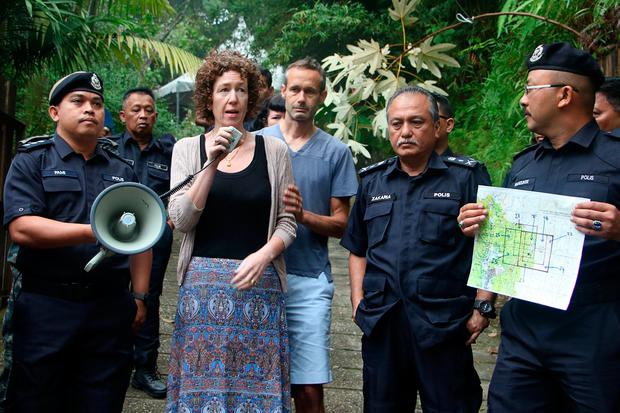 Meabh Quoirin thanks search teams looking for her daughter as dad Sebastien and police look on. Picture: AFP/Getty