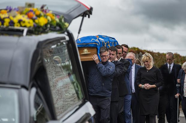 Mourners carry Jack's coffin at his funeral