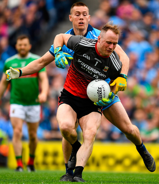 Bested: Mayo goalkeeper Rob Hennelly is tackled by Con O'Callaghan of Dublin. Photo: Ray McManus/Sportsfile