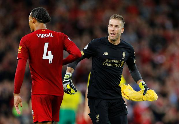 Liverpool's Adrian with Virgil van Dijk as he comes on as a substitute to replace Alisson in Friday's Premier League win over Norwich
