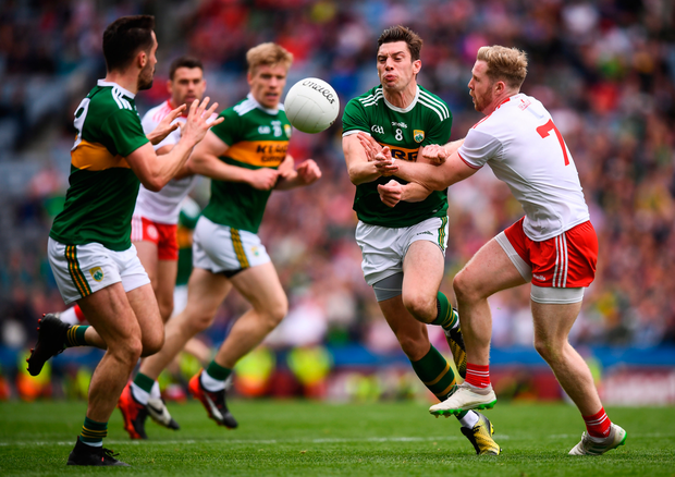 David Moran of Kerry in action against Frank Burns of Tyrone during the GAA Football All-Ireland Senior Championship Semi-Final match between Kerry and Tyrone at Croke Park in Dublin. Photo by Stephen McCarthy/Sportsfile