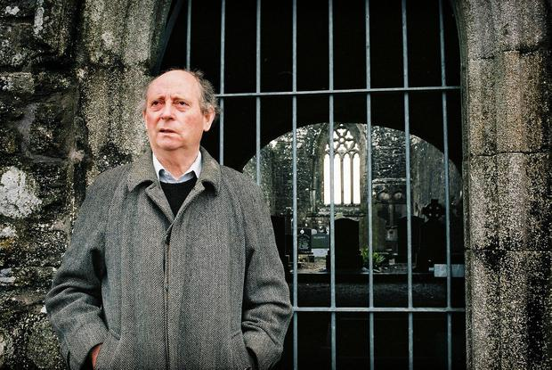 Acclaimed writer John McGahern at a graveyard near Mohill, Co Leitrim. Photo: Tony Gavin