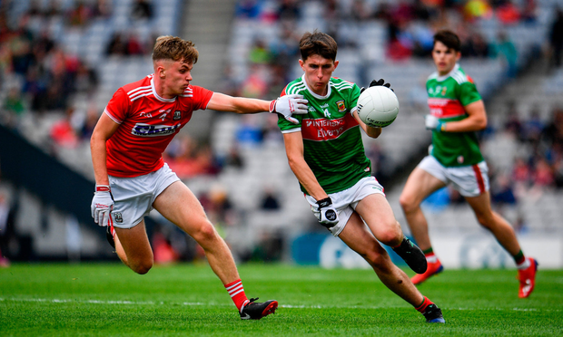 Mark Tighe of Mayo in action against Daniel Peet of Cork. Photo by Sam Barnes/Sportsfile