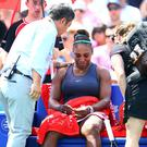 Serena Williamscan't hold back the tears after withdrawing from the final match against Bianca Andreescu of Canada due to a back injury (Photo by Vaughn Ridley/Getty Images)